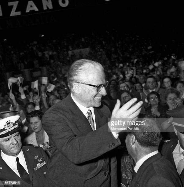 The President of the Italian Republic Giovanni Gronchi is radiant while he salutes the Italian emigrants in Buenosa Aires waving his hand Gronchi is...