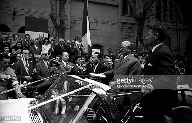 The President of the Italian Republic Giovanni Gronchi stands inside a convertible during a parade of honour in Buenos Aires streets Gronchi is the...
