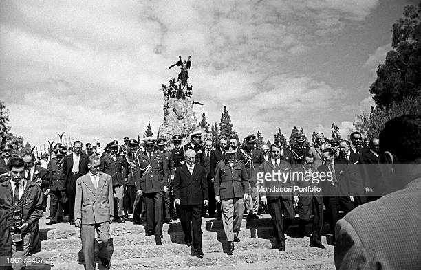 The President of the Italian Republic Giovanni Gronchi together with other authorities goes down the majestic staircase of the Andes Army memorial...