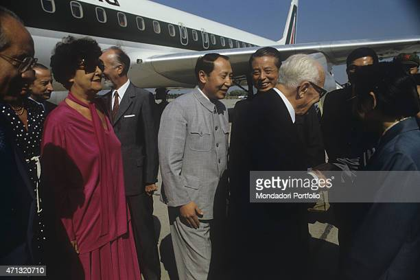 The President of the Italian Republic Sandro Pertini and his wife Carla Voltolina being welcomed at the airport while visiting China Beijing...