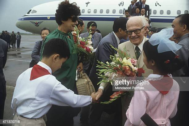 The President of the Italian Republic Sandro Pertini and his wife Carla Voltolina getting bunches of flowers while visiting China Beijing September...