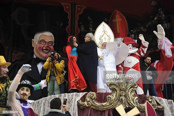 The President of the jury of the Carnival of Viareggio art critic Vittorio Sgarbi attends the traditional Carnival of Viareggio parade on February 7...