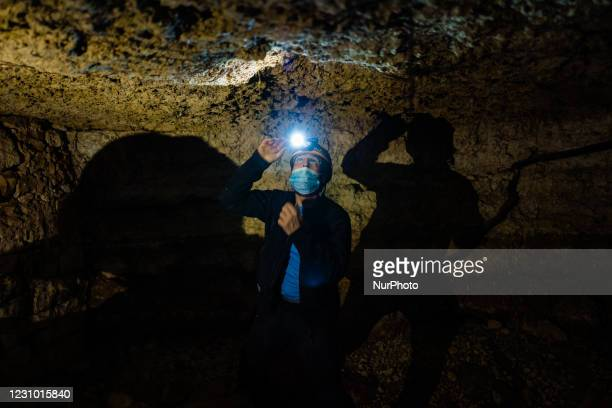 The president of the Melphicta Kalipè caves group, Fedele Messina, a volunteer speleologist, explores a newly discovered hypogeum in Molfetta on...