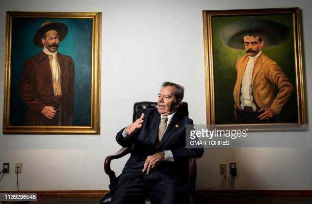 The President of the Mexican Low Chamber Porfirio Munoz Ledo of the MORENA party speaks during an interview with AFP next to paintings of Mexican...