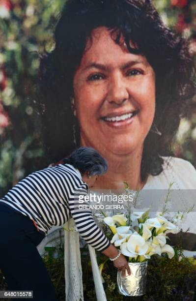 The president of the NGO Committee of Relatives of the Disappeared in Honduras Bertha Oliva lays a wreath on an alter in memory of murdered...