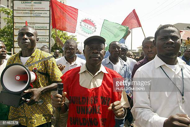 The President of the Nigeria Labour Congress Adams Oshiomhole leads a procession of workers 11 October 2004 during a protest rally by the congress in...