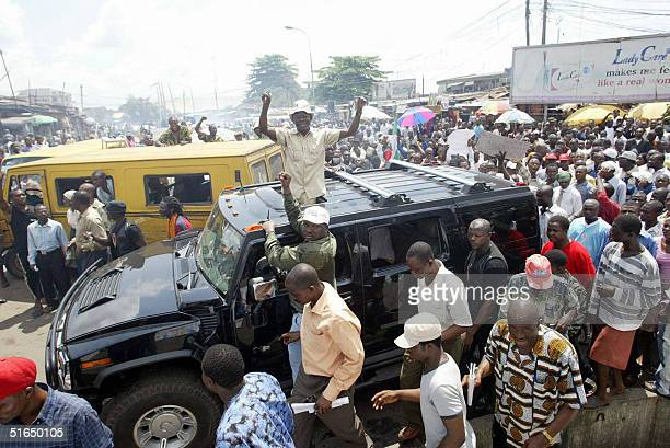 The president of the Nigeria Labour Congress Adams Oshiomhole waves to the crowd 03 October 2004 during a rally by workers' union in Lagos The union...