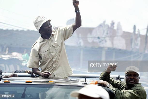 The president of the Nigeria Labour Congress Adams Oshiomhole waves to the crowd 03 October 2004 during a rally by the workers' union in Lagos The...