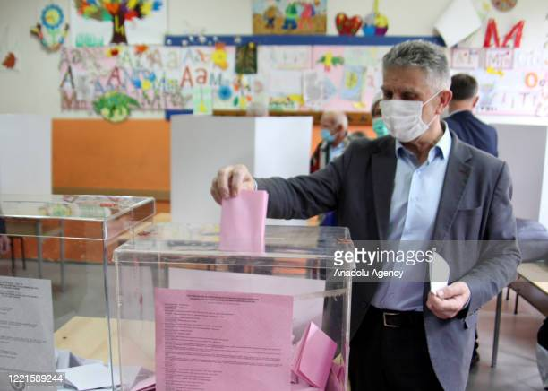 The president of the Party of Democratic Action of Sandzak Sulejman Ugljanin casts his vote at a polling station during parliamentary, provincial and...