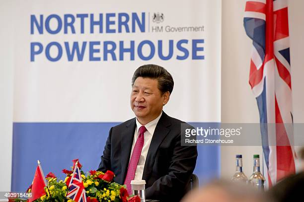 The President of the People's Republic of China Mr Xi Jinping tours the National Graphene Institute at Manchester University with the Chancellor of...