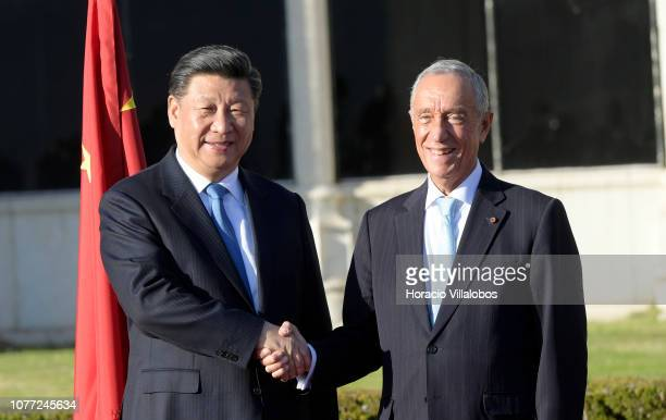 The President of the People's Republic of China Xi Jinping and his wife Peng Liyuan are greeted by Portuguese President Marcelo Rebelo de Sousa...
