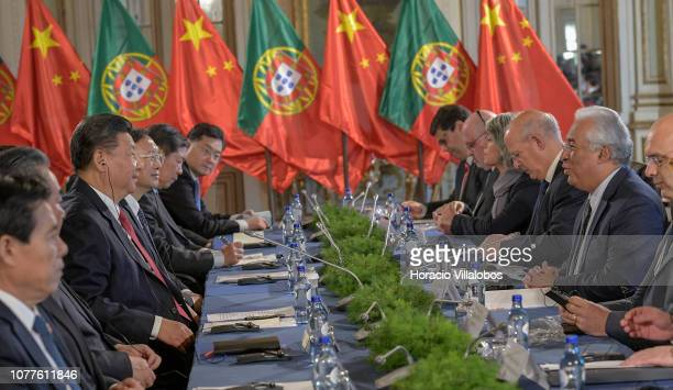 The President of the People's Republic of China Xi Jinping and Portuguese Prime Minister Antonio Costa are flanked by members of their cabinets...