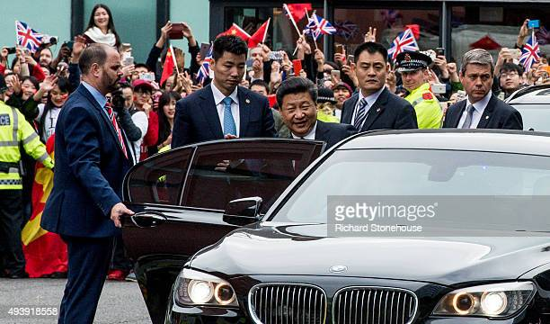 The President of the People's Republic of China Xi Jinping leaves following a tour of the National Graphene Institute at Manchester University with...