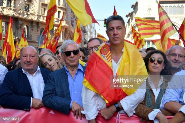 The President of the PP in Catalonia Xavier Garcia Albiol is pictured while wearing the flag of Spain on his shoulder with writer and Nobel prize for...