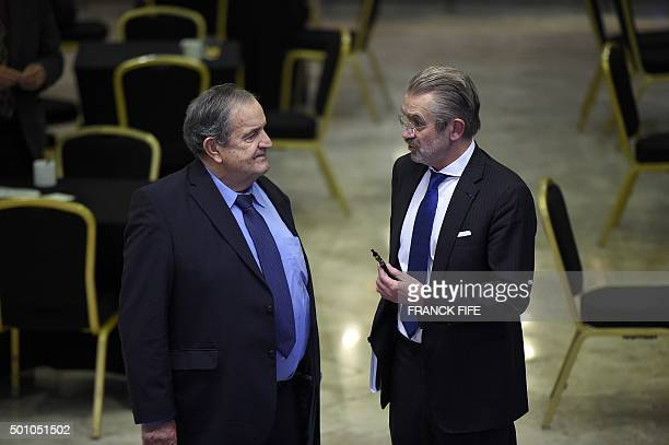 The president of the Professionnal French Football league Frederic Thiriez speaks with former french president of the French Football Federation...