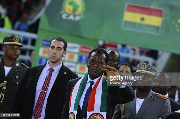 The President of the Republic of Equatorial Guinea, Teodoro Obiang Nguema Mbasogo greets the football fans ahead of the final football match between...