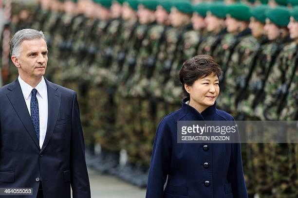 The president of the Republic of Korea, Park Geun-hye and the President of the Swiss confederation, Didier Burkhalter review troops during a state...