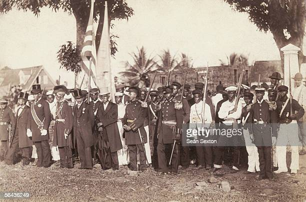 The President of the Republic of Liberia surrounded by his staff and soldiers circa 1890