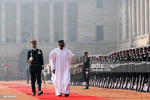 The President of the Republic of Mali Amadou Toumani Toure inspects the Guard of Honour during his ceremonial reception at the Presidential Palace on...