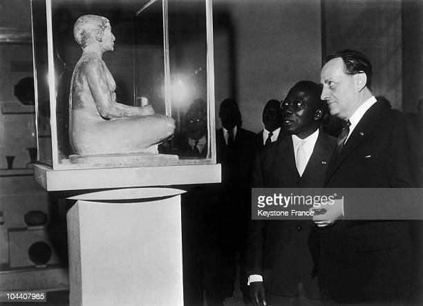 The President of the Republic of Senegal Leopold Sedar SENGHOR visiting the Louvre with the French Minister of Cultural Affairs Andre MALRAUX .