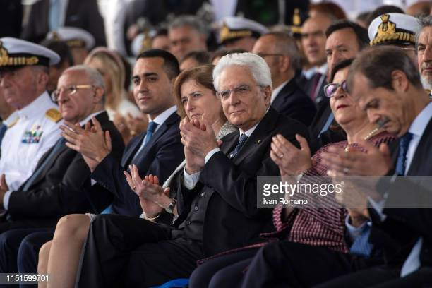 The President of the Republic Sergio Mattarella sits between his daughter Laura and the Minister of Defense Elisabetta Trenta near to the Labor...