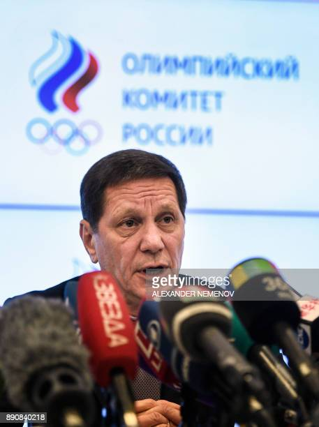 The President of the Russian Olympic Committee Alexander Zhukov answers reporters during a press conference in Moscow on December 12 within a meeting...
