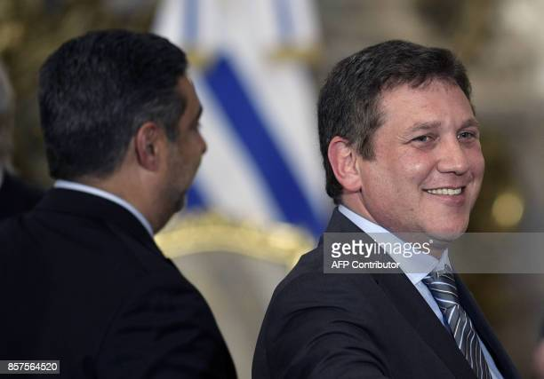 The President of the South American Football Confederation Alejandro Dominguez gestures next to Boca Juniors President Daniel Angelici while...