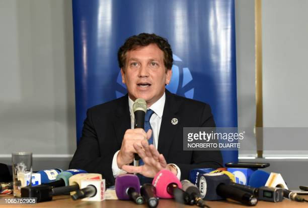 The president of the South American football's governing body Conmebol Paraguayan Alejandro Dominguez speaks to the press after holding a meeting...