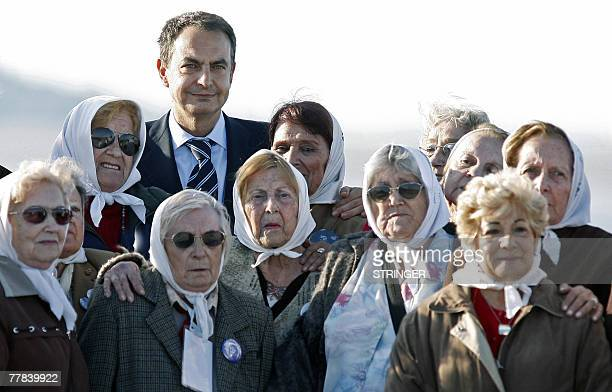 The President of the Spanish Government Jose Luis Rodriguez Zapatero poses for a picture with members of the Madres and Abuelas de Plaza de Mayo...
