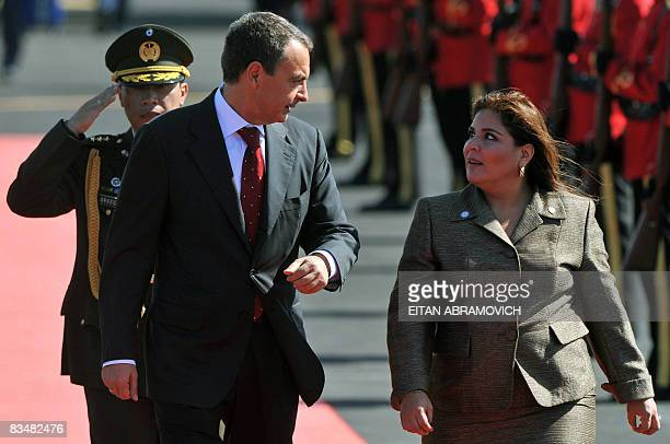 The President of the Spanish Government Jose Luis Rodriguez Zapatero talks with El Salvador's Foreign Minister Marisol Argueta upon his arrival to El...