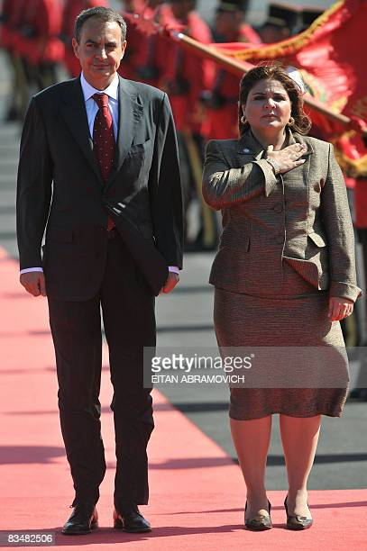 The President of the Spanish Government Jose Luis Rodriguez Zapatero stands next to El Salvador's Foreign Minister Marisol Argueta upon his arrival...