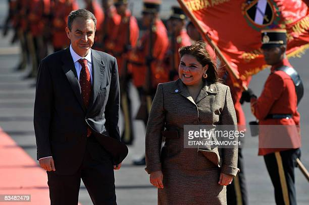 The President of the Spnish Government Jose Luis Rodriguez Zapatero is welcomed by El Salvador's Foreign Minister Marisol Argueta upon his arrival at...