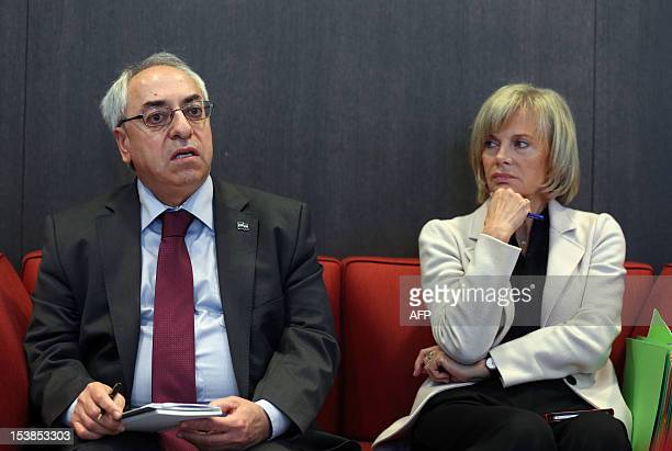 The president of the Syrian National Council Abdel Basset Sayda waits next to French Socialist deputy and former minister Elisabeth Guigou to be...