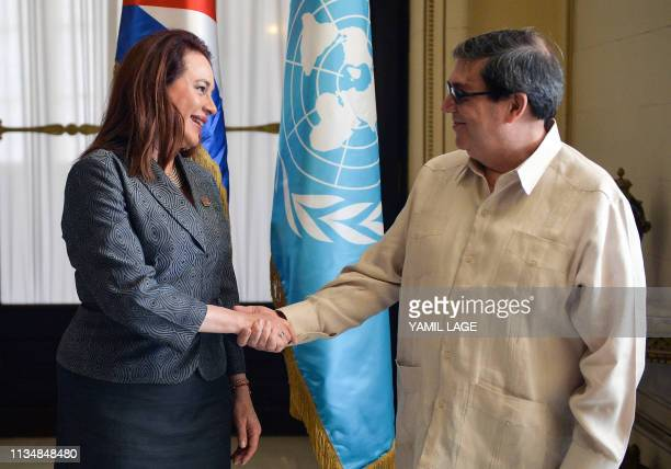 The President of the United Nations General Assembly Ecuadoran Maria Fernanda Espinosa Garces shakes hands with Cuban Foreign Affairs Minister Bruno...