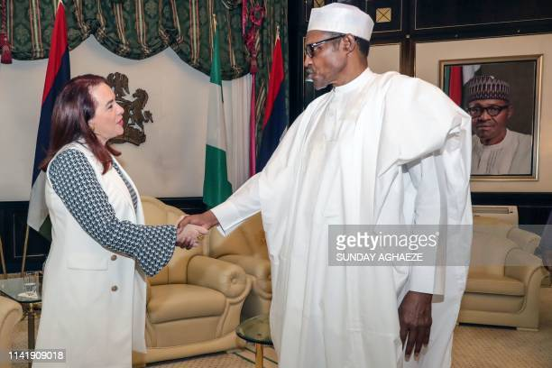 The President of the United Nations General Assembly Maria Fernanda Espinosa shakes hand with Nigerian President Mohammadu Buhari at the presidency...