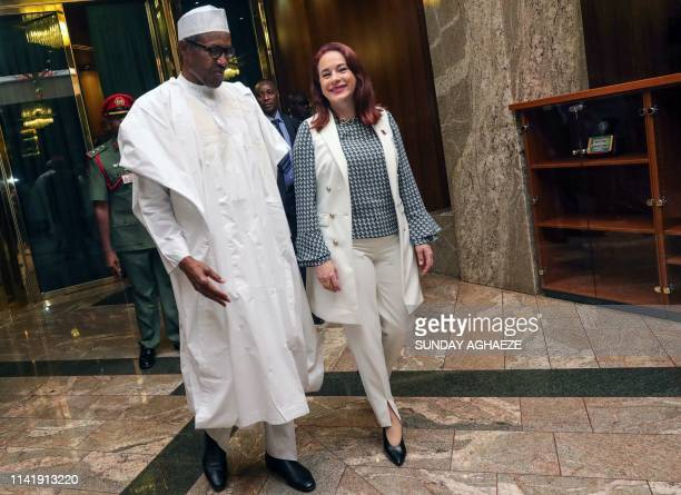 The President of the United Nations General Assembly Maria Fernanda Espinosa walks with Nigerian President Mohammadu Buhari upon her arrival at the...