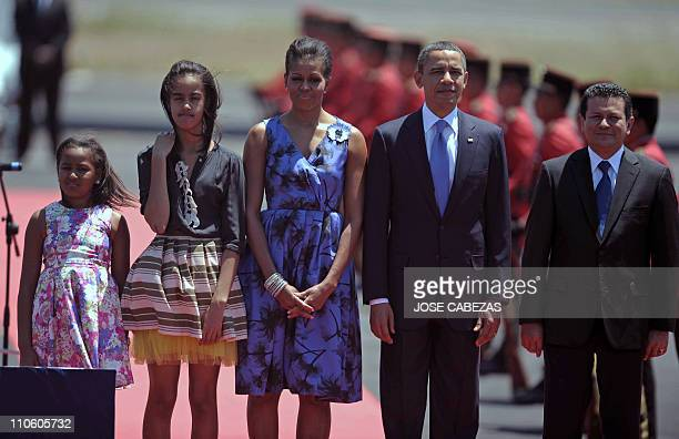 The president of The United States Barack Obama his wife Michelle and their daughters Sasha and Maila are welcomed by Salvadorean Foreign Minister...