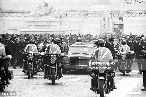The President of the United States of America Richard Nixon's car being escorted by the police while leaving the Altar of the Fatherland Rome...