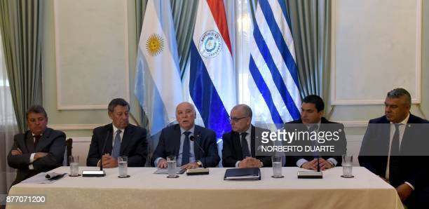The president of the Uruguayan Football Association Wilmar Valdez Uruguay's Foreign Minister Rodolfo Nin Novoa Paraguayan Foreign Minister Eladio...