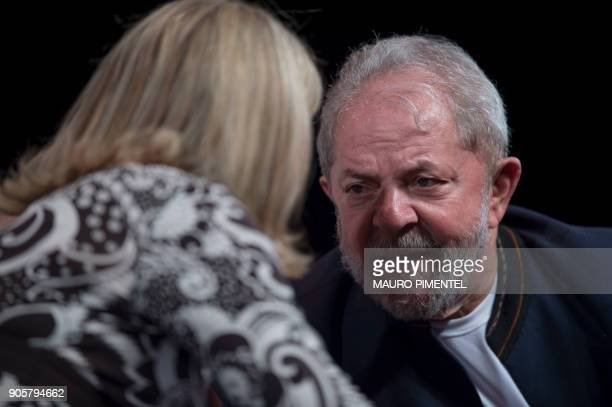 The president of the Workers Party Gleisi Hoffmann speaks with former Brazilian president Luiz Inacio Lula da Silva during a meeting with...