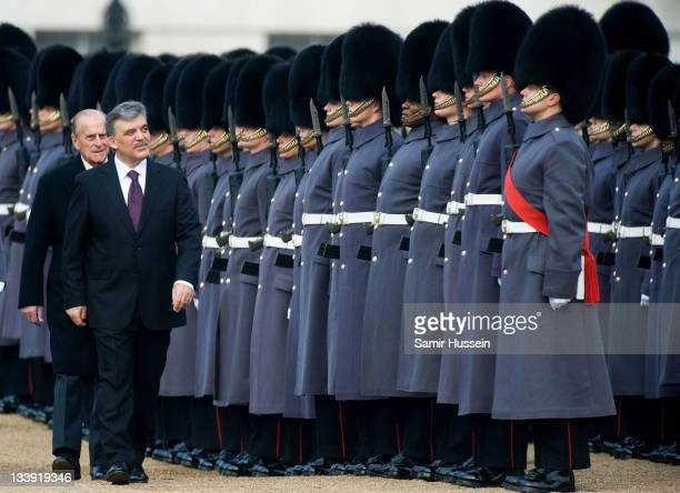 The President of Turkey Abdullah Gul inspects the Guard of Honour with Prince Philip Duke of Edinburgh on Horse Guards Parade on November 22 2011 in...