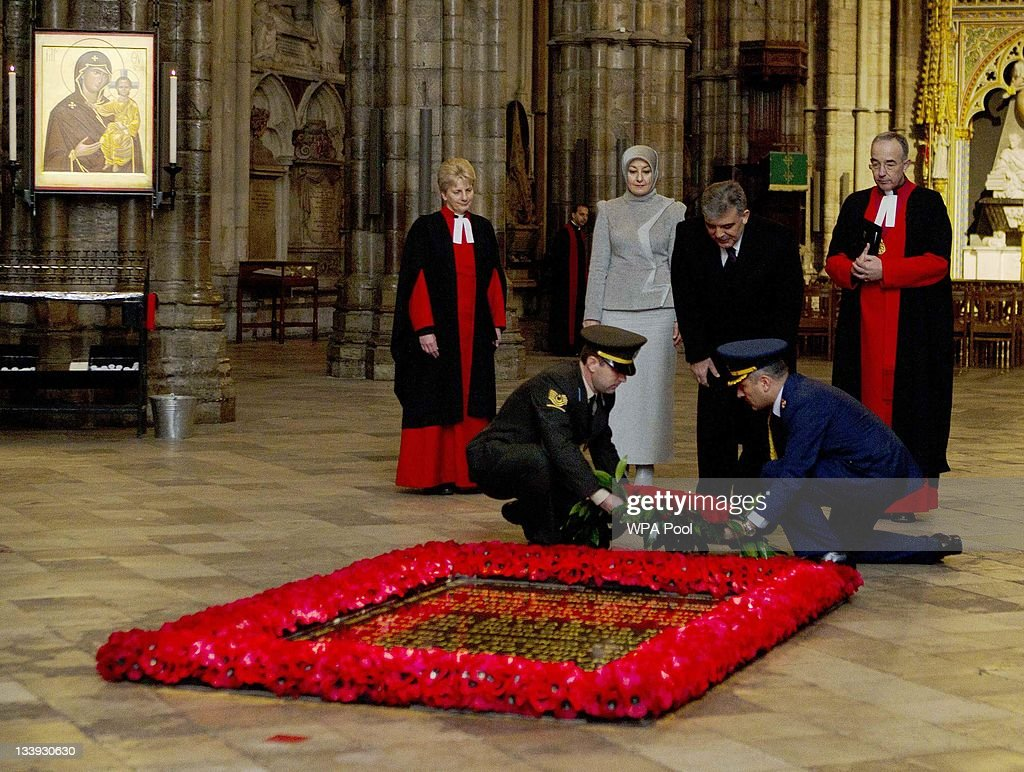 The President of Turkey Abdullah Gul (C), watched by his wife Hayrunnnisa Gul (2nd L), lays a wreath at the tomb of the unknown soldier in Westminster Abbey on November 22, 2011 in London, England. The President of Turkey is on a five day State visit to the UK.