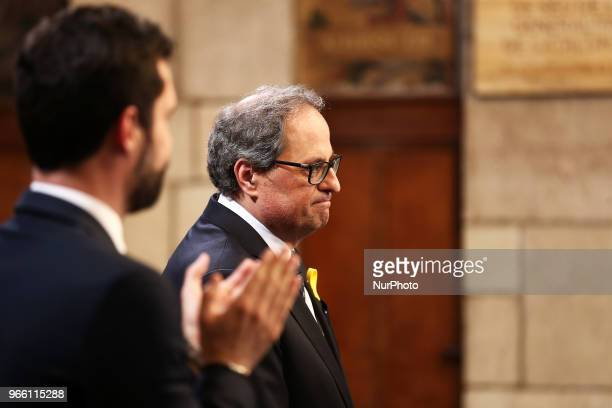 the president Quim Torra and the president of the Parliament Roger Torrent during the swearingin ceremony of the new Government of the Generalitat of...