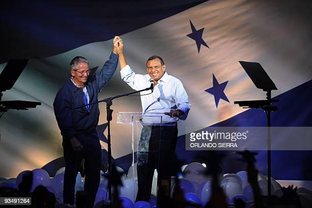 The presidentelect of Honduras Porfirio Lobo greets supporters with former president Ricardo Maduro in Tegucigalpa on November 30 2009 Conservative...