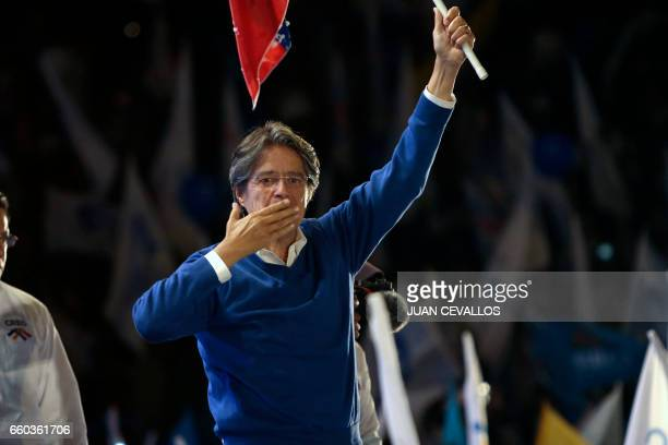 The presidential candidate for the Creating Opportunities party Guillermo Lasso flutters an Ecuadorean national flag during the closing rally of his...