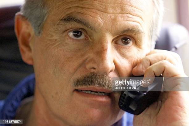 The presidential candidate for the Institutional Revolutionary Party Francisco Labastida speaks on a cellular phone from his campaign bus 11 May 2000...