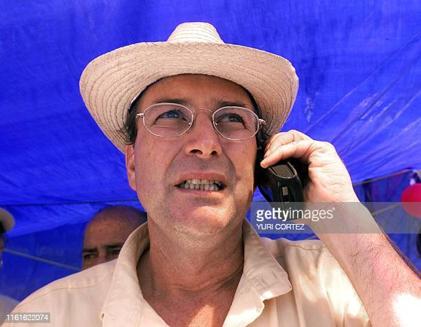 The presidential candidate for the Partido Accion Ciudadana Otton Solis seen wearing a typical hat and talks on the cellular phone 03 February 2002...