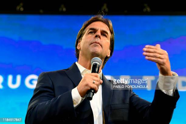 The presidential candidate for Uruguay's Partido Nacional party Luis Lacalle addresses supporters alongside coalition members following the results...