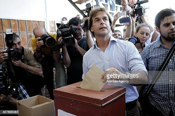 The presidential candidate of the National Party Luis Lacalle Pou casts his vote during 2014 presidential election at a polling station in Canelones...