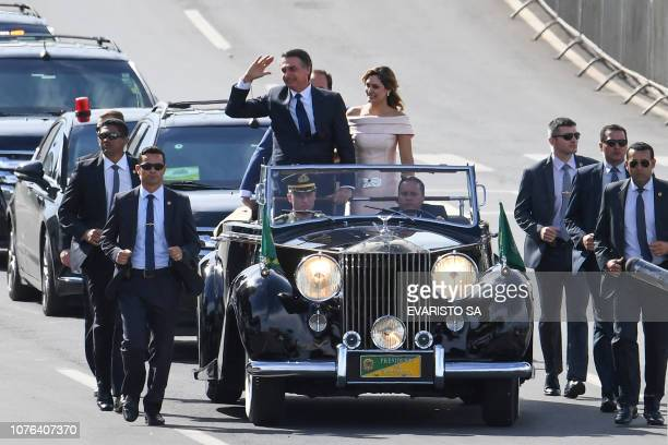 The presidential convoy led by Brazil's new President Jair Bolsonaro and his wife Michelle Bolsonaro heads towards Planalto Palace to receive the...